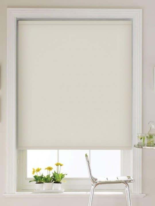 Cream dim out roller blind