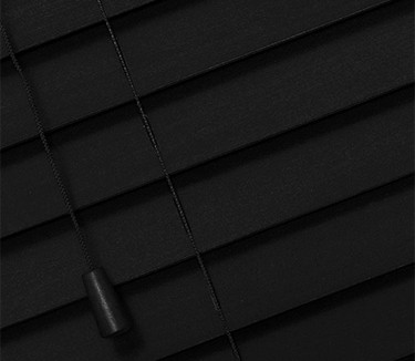 black wooden venetian blinds with cords close up