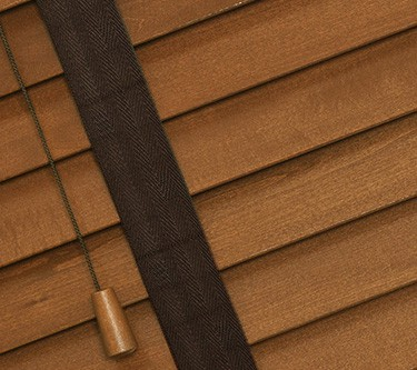 medium oak wooden venetian blinds with tapes close up