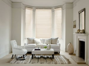 cream painted wood venetian blinds with cords