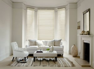 ivory wood venetian blinds with cords close up