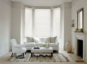 white painted wooden venetian blinds with cords